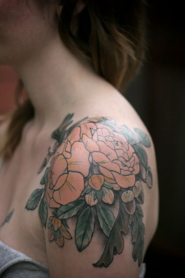 Lovely flowers shoulder tattoo by Kirsten Holliday