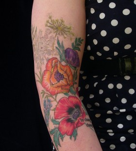 Lovely flowers tattoo by Esther Garcia