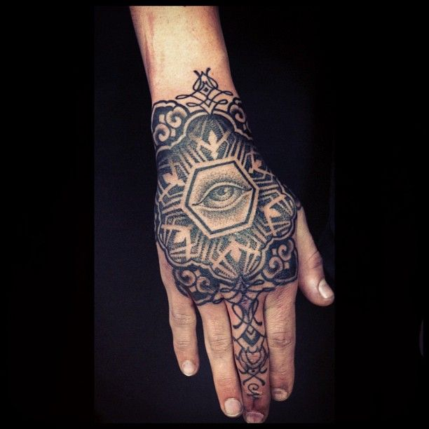 Lovely hand tattoo by Brian Gomes