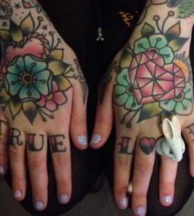 Lovely hand tattoos by Clare Hampshire