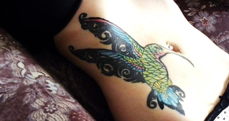 Lovely hummingbird stomach tattoo