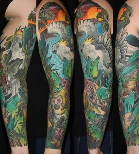 Lovely jungle animals arm tattoo