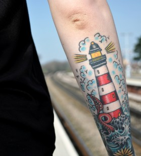 Lovely lighthouse arm tattoo