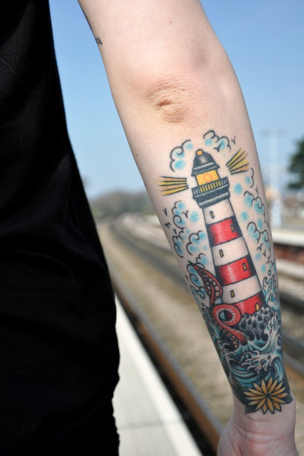 Lovely lighthouse arm tattoo