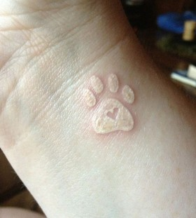 Lovely looking dog's palm tattoo