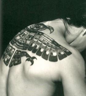 Lovely looking tribal bird tattoo