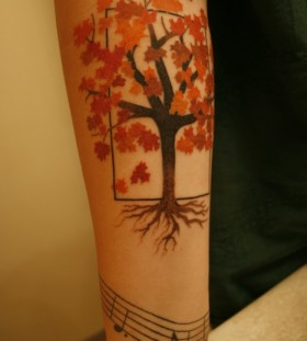 Lovely maple tree tattoo