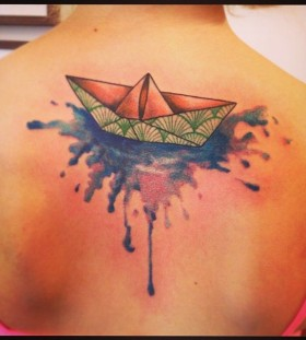 Lovely origami boat back tattoo
