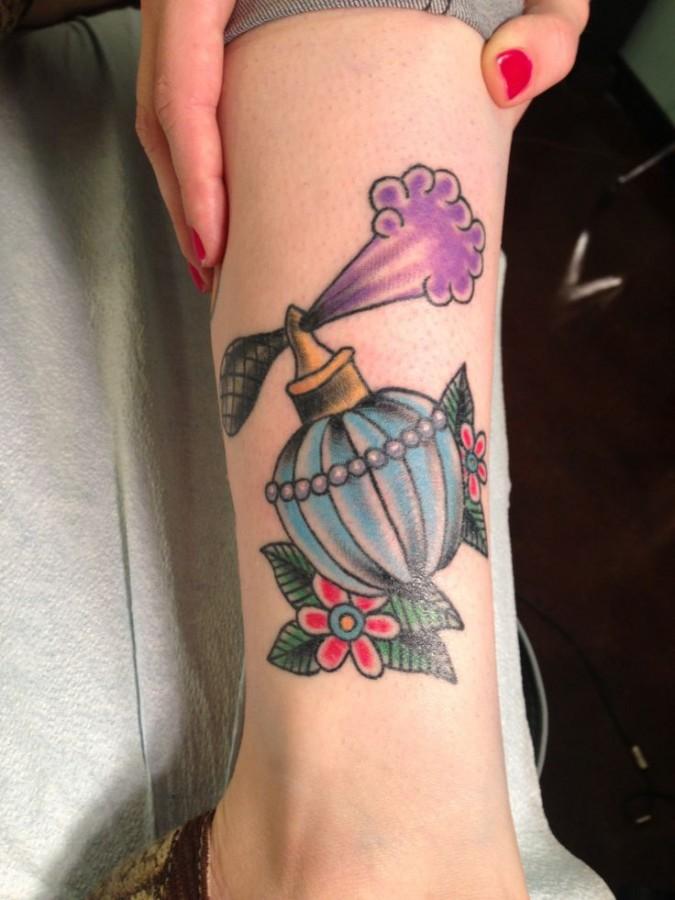 Lovely perfume bottle tattoo