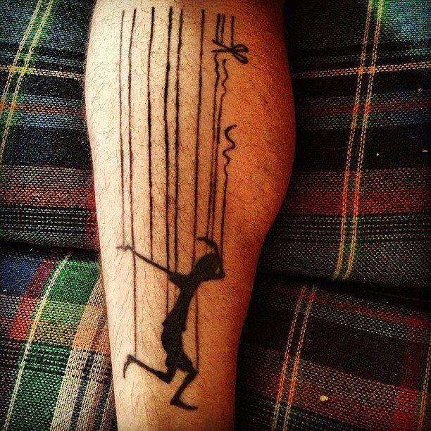 Lovely puppet leg tattoo