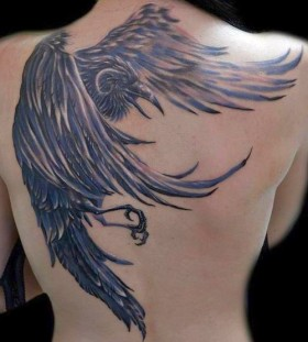 Lovely raven back tattoo