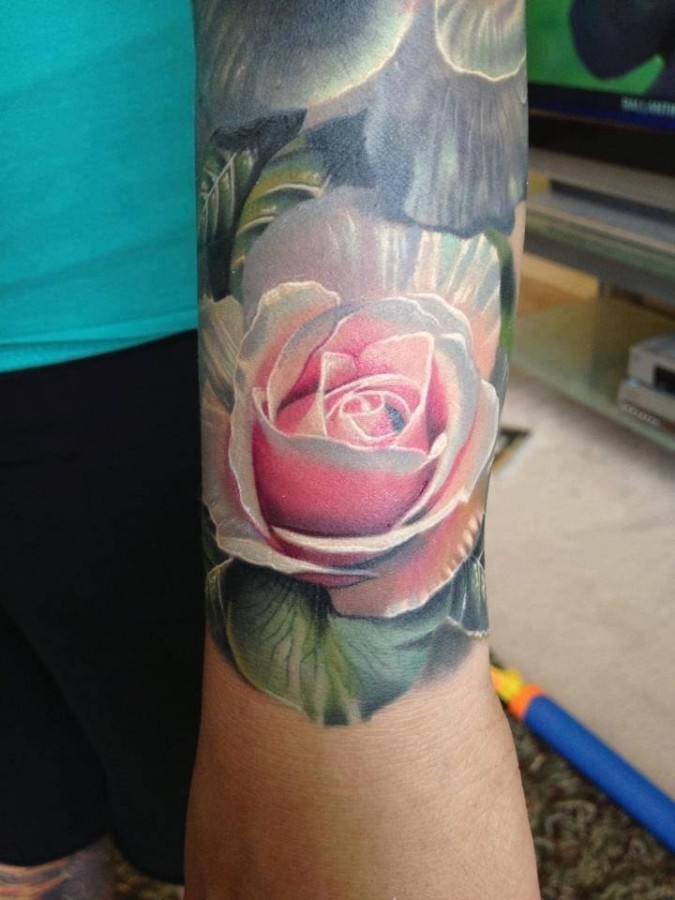 Lovely rose tattoo by Phil Garcia