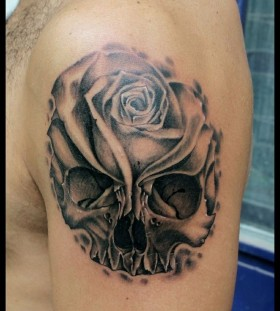 Lovely skull and flower tattoo