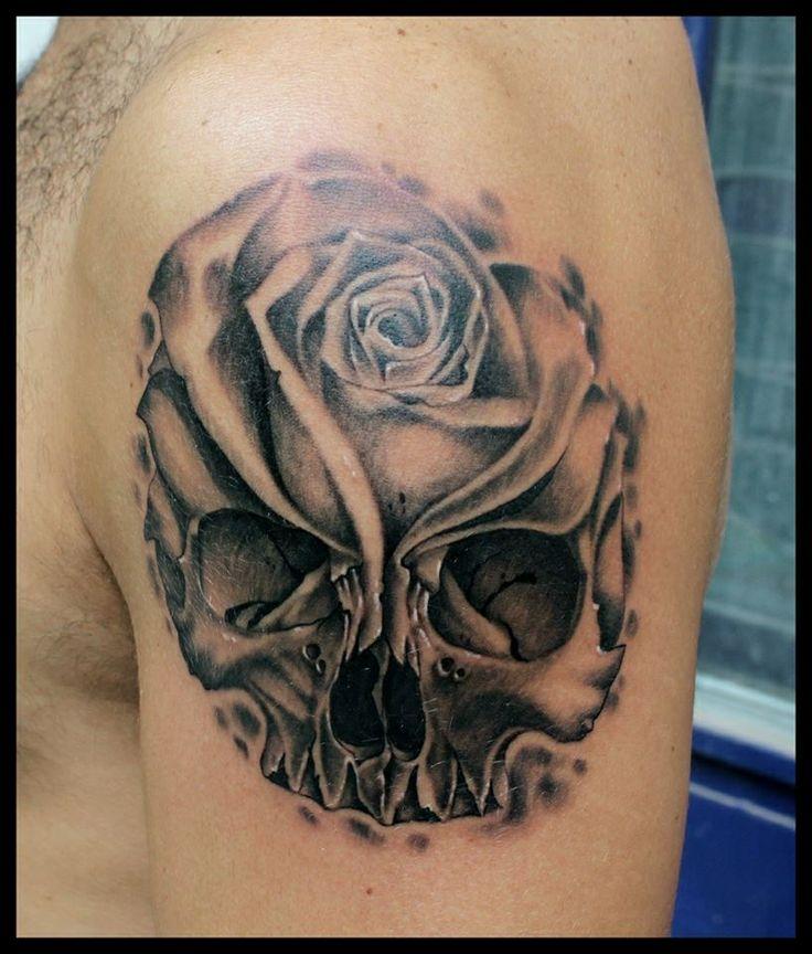 Lovely skull and flower tattoo