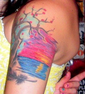 Lovely sunset arm tattoo