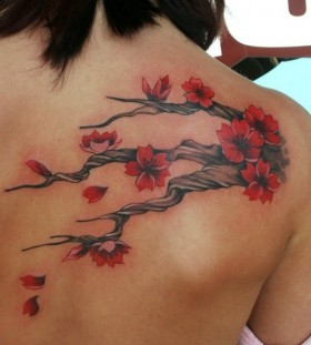 Lovely tree branch back tattoo