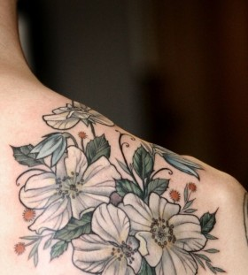 Lovely white flowers tattoo by Alice Kendall