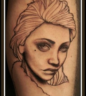 Lovely woman arm tattoo