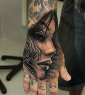 Lovely woman hand tattoo by Riccardo Cassese