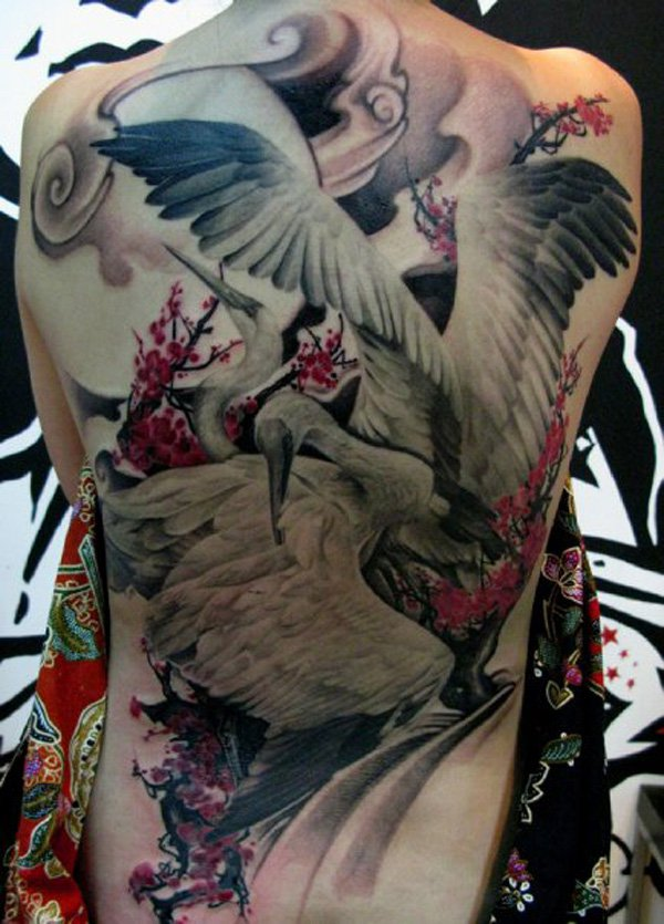 Magical crane back tattoo