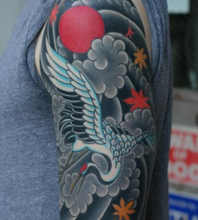 Magnificent crane arm tattoo
