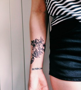 Malaysian flowers tattoo by Rebecca Vincent