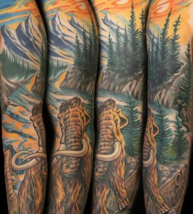 Mammoth and landscape tattoo