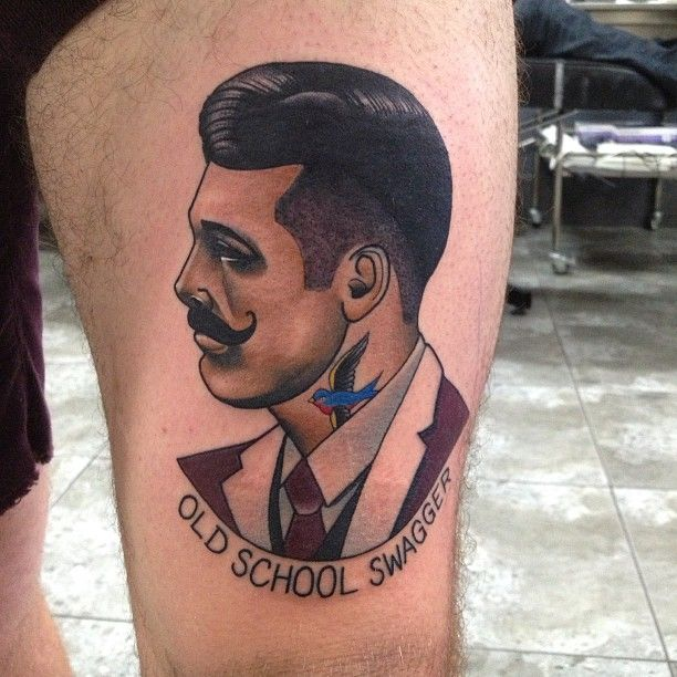 Man and writing tattoo by Dan Molloy