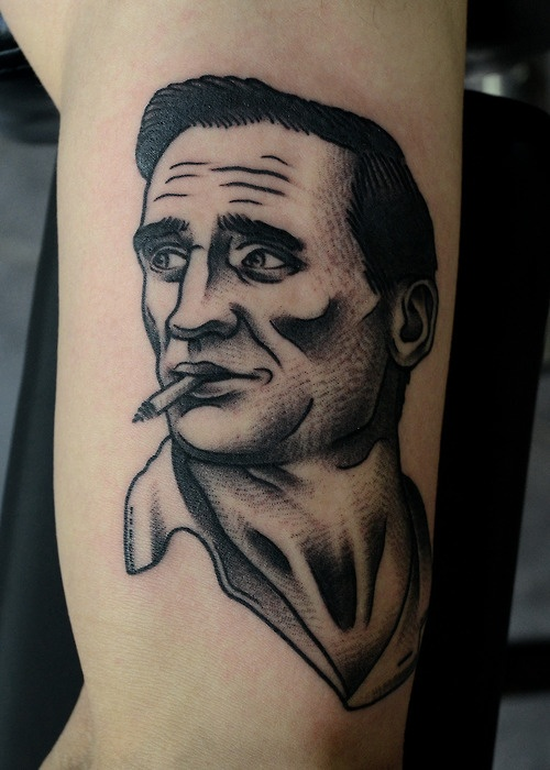 Man smoking a cigarette tattoo by Philip Yarnell