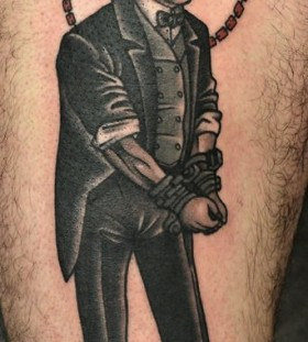 Man tied with chains tattoo by Philip Yarnell