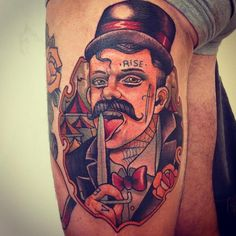 Man with a knife tattoo by Alex Dorfler