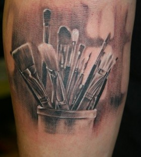 Many paint brushes tattoo