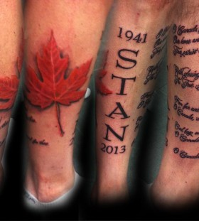 Maple leaf and quote tattoo