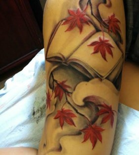 Maple leaves and book tattoo