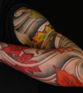 Maple leaves full sleeve tattoo
