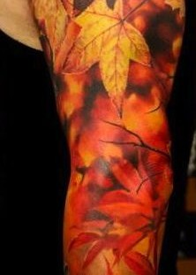 Maple leaves tattoo by Dmitriy Samohin
