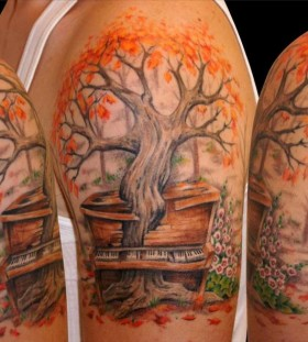 Maple tree arm tattoo