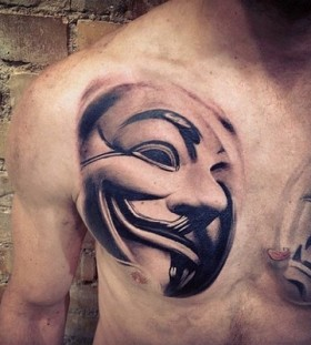 Mask of V chest tattoo