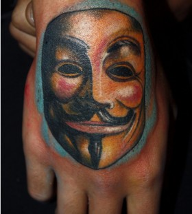 Mask of V hand tattoo
