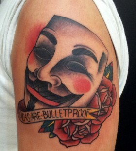 Mask of V with quote tattoo