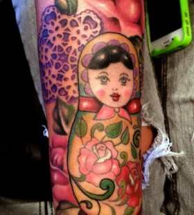 Matryoshka and flowers tattoo