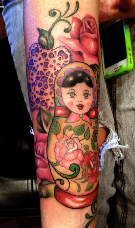 Matryoshka and flowers tattoo