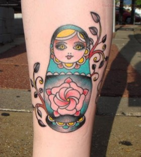 Matryoshka with flower tattoo