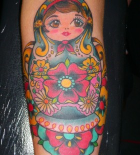 Matryoshka with many flowers tattoo