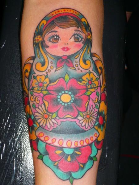 Matryoshka with many flowers tattoo