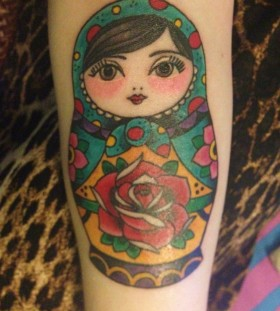 Matryoshka with rose tattoo