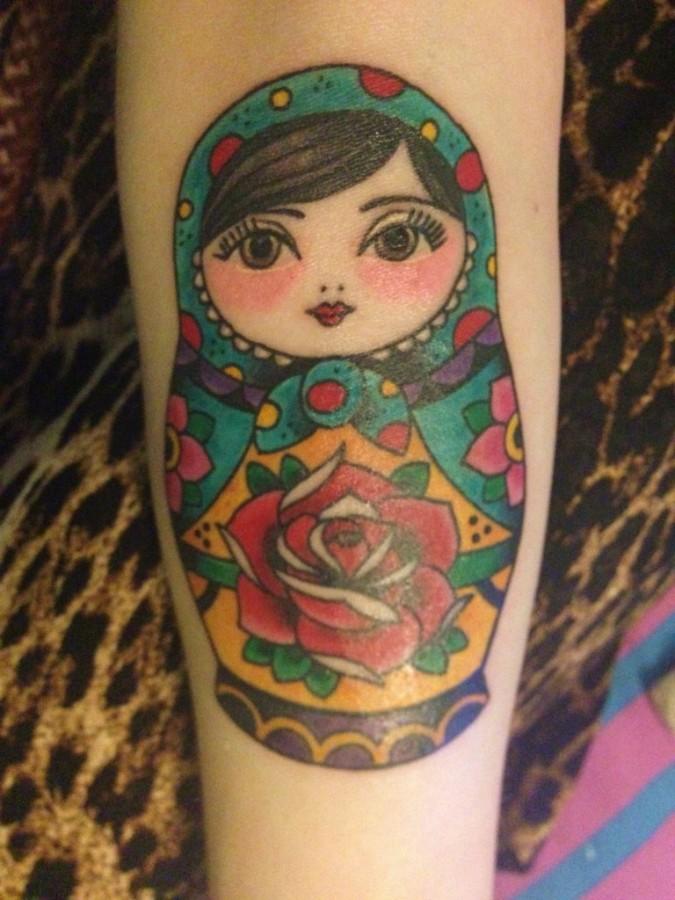 Matryoshka with rose tattoo