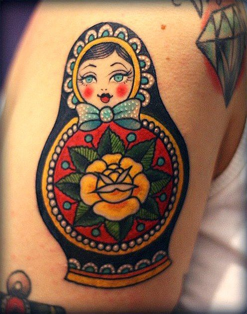 Matryoshka with yellow flower tattoo