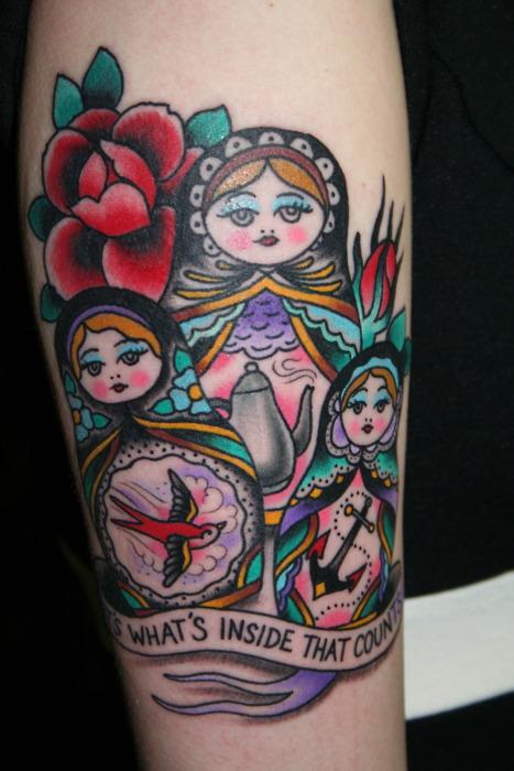 Matryoshkas and writing tattoo