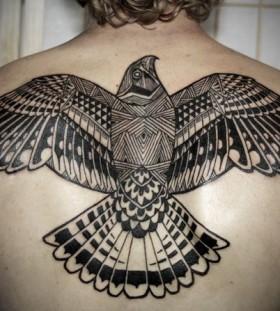 Men's back tribal bird tattoo